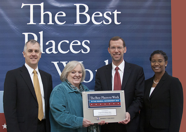 CBO staff accept award for agency's ranking as one of the best places to work in the federal government